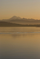 Sunrise at Anacortes, Washington, with the Cascade Mountains in background.