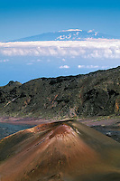 Pu'u O Maui cinder cone in the crater of HALEAKALA NATIONAL PARK on Maui in Hawai with a backdrop of snow covered Mauna Loa on the Big Islandi