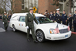 National Park Service Honor Guard walk along side with the hearse carrying the casket of National Park Service Ranger Margaret Anderson  during a memorial service at the Pacific Lutheran University in Tacoma on January 10, 2010.  Ranger Margaret Anderson, was slain at Mount Rainier on New Years' Day when she set up a road block to intercept a vehicle, driven by Benjamin Barnes, who failed to stop at a chain-up checkpoint.  Barnes, the suspect  in the shooting was found dead was found dead the next day. He had drown in Paradise Creek.   ©2012. Jim Bryant Photo. All RIGHTS RESERVED.