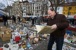 BRUSSELS - BELGIUM - 08 JANUARY 2012 -- Marolles the bohemian city part of Brussels. -- The most famous flee-market of Brussels on Place Jeu de Balle. Roland de Raeve found an old album on botanics. -- PHOTO: Juha ROININEN /  EUP-IMAGES