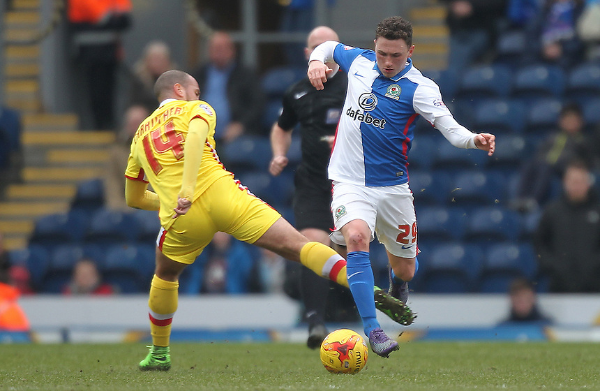 Blackburn Rovers Corry Evans skips past Milton Keynes Dons Samir Carruthers<br /> <br /> Photographer Mick Walker/CameraSport<br /> <br /> Football - The Football League Sky Bet Championship - Blackburn Rovers v Milton Keynes Dons - Saturday 27th February 2016 - Ewood Park - Blackburn<br /> <br /> &copy; CameraSport - 43 Linden Ave. Countesthorpe. Leicester. England. LE8 5PG - Tel: +44 (0) 116 277 4147 - admin@camerasport.com - www.camerasport.com