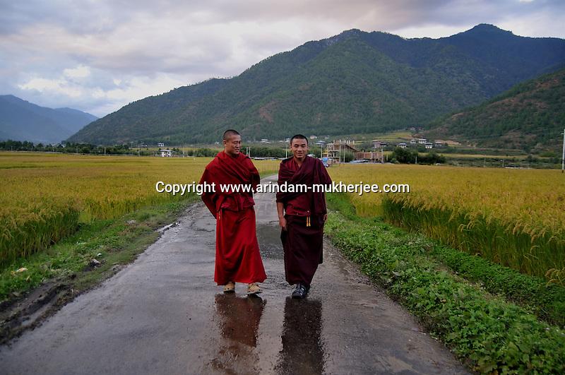 Buddhist lamas on a road in Paro. Arindam Mukherjee..