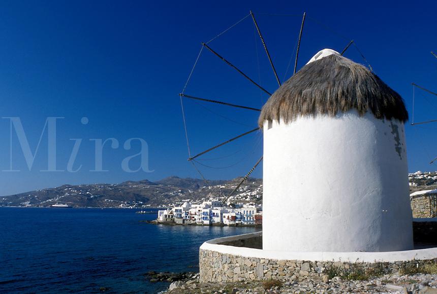 windmill, Mykonos, Greek Islands, Cyclades, Greece, Europe, Windmill on Mykonos and view of harbor on the Aegean Sea.