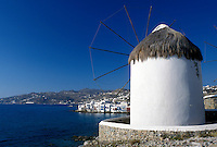 windmill, Mykonos, Greek Islands, Cyclades, Greece, Europe, Windmill on Mykonos and view of harbor on the Aegean Sea.