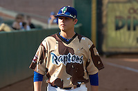 Jake Fisher (30) of the Ogden Raptors prior to the game against the Great Falls Voyagers at Lindquist Field on August 16, 2013 in Ogden Utah. Military Appreciation Night saw the Raptors take the field in camouflage uniforms. (Stephen Smith/Four Seam Images)