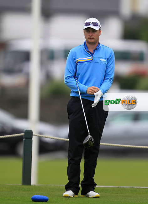 Simon Ward (Co. Louth) on the 1st tee during the South of Ireland Amateur Open Championship Semi-Finals at Lahinch Golf Club  31th July 2013 <br /> Picture:  Thos Caffrey / www.golffile.ie