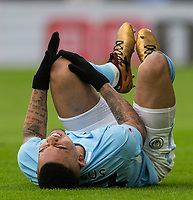 Gabriel Jesus of Manchester City holds his knee in pain as he does down with injury during the Premier League match between Crystal Palace and Manchester City at Selhurst Park, London, England on 31 December 2017. Photo by Andy Rowland.