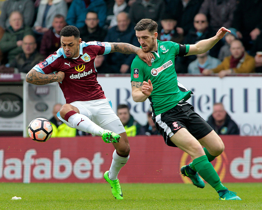 Burnley's Andre Gray battles with Lincoln City's Luke Waterfall<br /> <br /> Photographer David Shipman/CameraSport<br /> <br /> Emirates FA Cup Fifth Round - Burnley v Lincoln City - Saturday 18th February 2017 - Turf Moor - Burnley <br />  <br /> World Copyright &copy; 2017 CameraSport. All rights reserved. 43 Linden Ave. Countesthorpe. Leicester. England. LE8 5PG - Tel: +44 (0) 116 277 4147 - admin@camerasport.com - www.camerasport.com