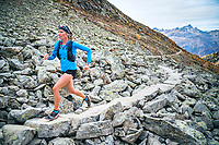 Trail running above Pontresina, Switzerland on a stone trail.