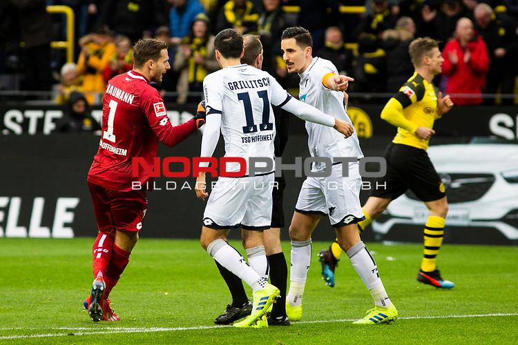 09.02.2019, Signal Iduna Park, Dortmund, GER, 1.FBL, Borussia Dortmund vs TSG 1899 Hoffenheim, DFL REGULATIONS PROHIBIT ANY USE OF PHOTOGRAPHS AS IMAGE SEQUENCES AND/OR QUASI-VIDEO<br /> <br /> im Bild | picture shows:<br /> Oliver Baumann (Hoffenheim #1) und Benjamin Huebner (Hoffenheim #21) diskutieren mit Schiedsrichter | Referee Marco Fritz über den Treffer der Dortmunder,  <br /> <br /> Foto © nordphoto / Rauch