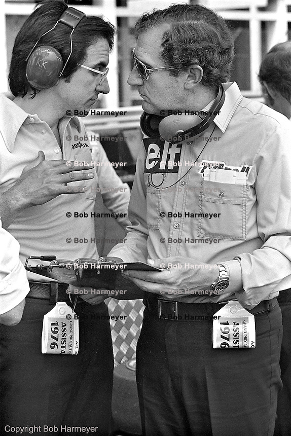 Derek Gardner (right), designer of the Tyrrell P34 six-wheel Formula 1 car, speaks with Goodyear engineer Dr. Karl Kempf in the pit lane during practice for the 1976 Grand Prix of Monaco.