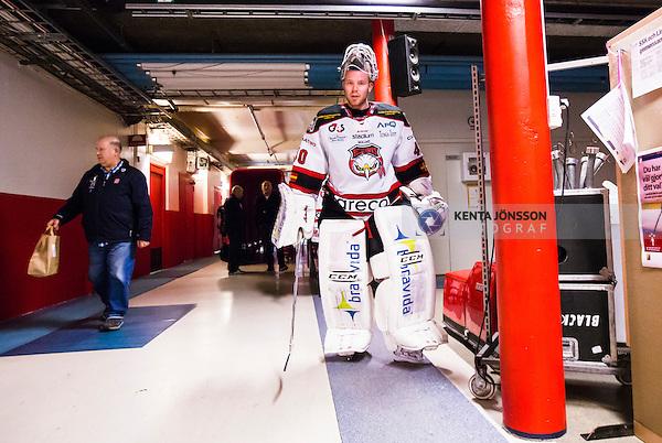 S&ouml;dert&auml;lje 2014-10-23 Ishockey Hockeyallsvenskan S&ouml;dert&auml;lje SK - Malm&ouml; Redhawks :  <br /> Malm&ouml; Redhawks m&aring;lvakt Pontus Sj&ouml;gren p&aring; v&auml;g in till omkl&auml;dningsrummet efter matchen mellan S&ouml;dert&auml;lje SK och Malm&ouml; Redhawks <br /> (Foto: Kenta J&ouml;nsson) Nyckelord: Axa Sports Center Hockey Ishockey S&ouml;dert&auml;lje SK SSK Malm&ouml; Redhawks portr&auml;tt portrait
