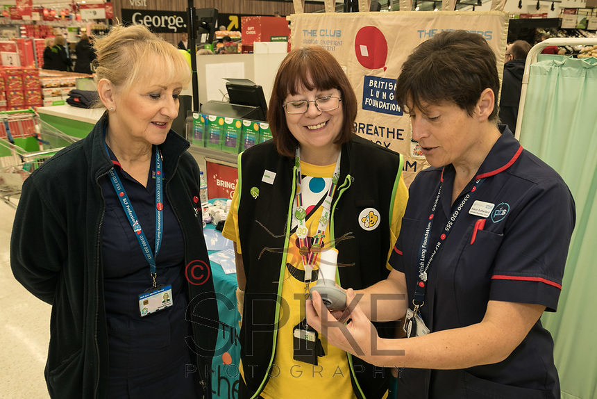 Asda Community Champion Christine Conway sees the results of the spirometer test with Specialist Respiratory Nurse Alison Sutherland (right) watched by Elizabeth Marden
