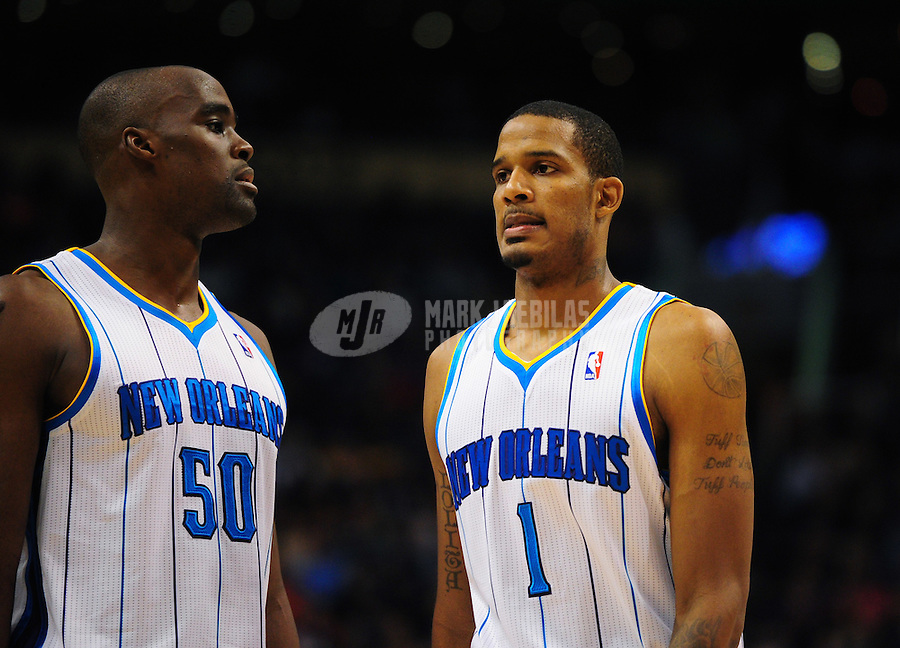 Dec. 26, 2011; Phoenix, AZ, USA; New Orleans Hornets guard/forward Trevor Ariza (1) and teammate Emeka Okafor during the game against the Phoenix Suns at the US Airways Center. The Hornets defeated the Suns 85-84. Mandatory Credit: Mark J. Rebilas-USA TODAY Sports