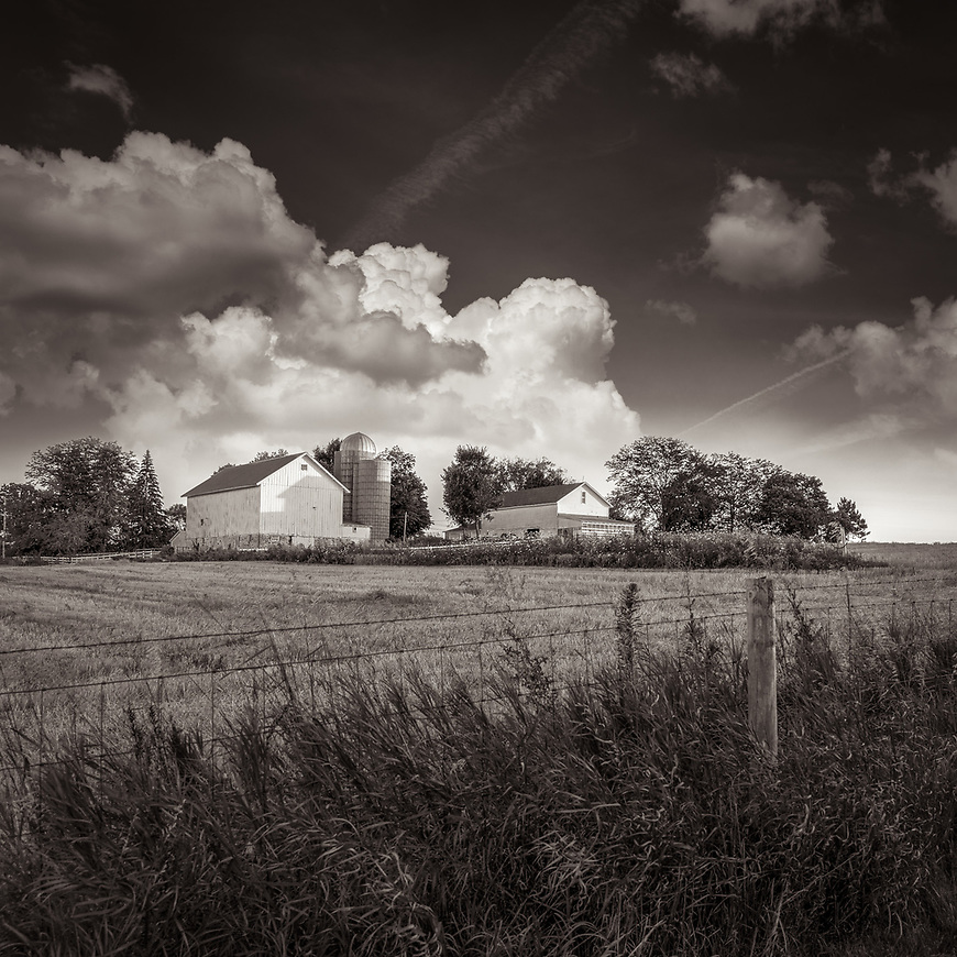 FARMSTEAD -- A summer sunset at the Pope farm in Middleton, Wisconsin, USA. #michaelknapstein #midwestmemoir #blackandwhite #B&W #monochrome #motherfstop #wisconsin  #bwphotography #myfeatureshoot  #fineartphotography #americanmidwest #squaremag #lensculture #mifa #moscowfotoawards #moscowinternationalfotoawards #rps #royalphotographicsociety #CriticalMass #CriticalMassTop200 #photolucida  #portfolioshowcase11 #thegalaawards #thepolluxawards #flakphoto #ipe160 #ipe161 #grainedephotographe  #galleryofwisconsinart