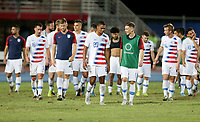 GEORGETOWN, GRAND CAYMAN, CAYMAN ISLANDS - NOVEMBER 19: Reggie Cannon #20 and Wil Trapp #6 of the United States chat while exiting the pitch with their USMNT teammates during a game between Cuba and USMNT at Truman Bodden Sports Complex on November 19, 2019 in Georgetown, Grand Cayman.