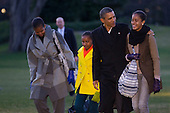 United States President Barack Obama and first lady Michelle Obama, left, walk with their daughters Sasha Obama, second left, and Malia Obama, right, after disembarking from Marine One on the South Lawn of the White House in Washington, D.C., U.S., on Tuesday, January 3, 2012. The first family arrived after a 10-day vacation in Hawaii. .Credit: Andrew Harrer / Pool via CNP