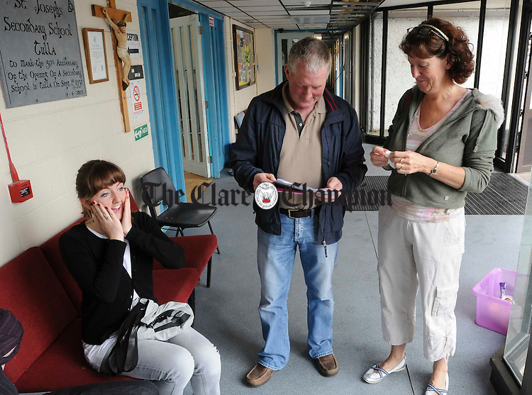 Jill Mc Mahon takes it all in as her mam Zita and her Dad Harry look through her Leaving Certificate Results after recieving them at St Joseph's Secondary School, Tulla. Photograph by John Kelly.