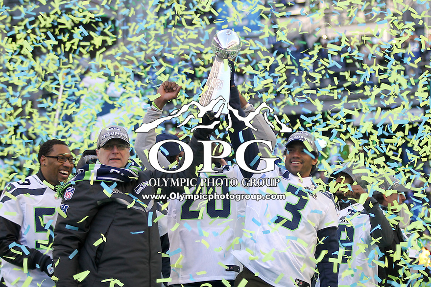 2014-02-05:  Seattle Seahawks owner Paul Allen and quarterback Russell Wilson hoisted the Super Bowl trophy up in the air together. Seattle Seahawks players and 12th man fans celebrated bringing the Lombardi trophy home to Seattle during the Super Bowl Parade at Century Link Field in Seattle, WA.
