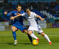 23rd November 2019; Caledonian Stadium, Inverness, Scotland; Scottish Championship Football, Inverness Caledonian Thistle versus Dundee Football Club; Paul McGowan of Dundee challenges for the ball with Brad McKay of Inverness Caledonian Thistle  - Editorial Use