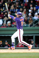 Right fielder Steven Duggar (9) of the Clemson Tigers bats in the Reedy River Rivalry game against the South Carolina Gamecocks on Saturday, February 28, 2015, at Fluor Field at the West End in Greenville, South Carolina. South Carolina won, 4-1. (Tom Priddy/Four Seam Images)