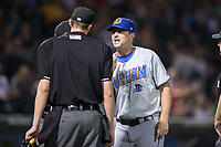 Durham Bulls manager Jared Sandberg (22) argues a call with home plate umpire Eric Gillam during the game against the Charlotte Knights at BB&T BallPark on May 15, 2017 in Charlotte, North Carolina. The Knights defeated the Bulls 6-4.  (Brian Westerholt/Four Seam Images)