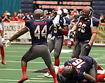 SIOUX FALLS, SD - JUNE 7 Eze Obiora #44 from the Sioux Falls Storm celebrates a sack by teammate James Dunlap #16 against the Texas Revolution in the first quarter of their game Saturday night at the Sioux Falls Arena. (Photo by Dave Eggen/Inertia)