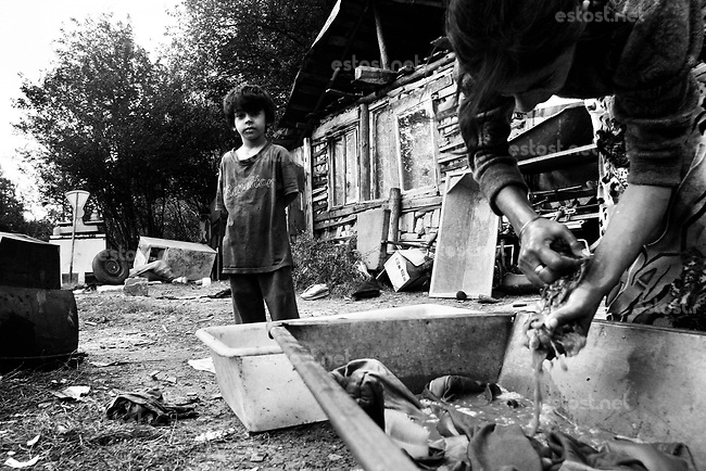 SERBIA, Belgrade, Oct. 15, 2006..A gypsy family seen in fron of their home located in isolated ghetto-like settlement on outskirts of Belgrade, Serbia, Monday, Oct. 15, 2006. The Smaili family fled Kosovo in 1999 and are now living in a ghetto among 36 other families without electricity or water. The status of the Serbian southern province still remains unresolved while Serbia is woating on a public referendum for new Serbian constitution.  © Djordje Jovanovic /EST&OST