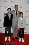 Jeff Tweedy - honoree and sons Basil and Miles - Skating with the Stars - a benefit gala for Figure Skating in Harlem in its 17th year is celebrated with many US, World and Olympic Skaters honoring Michelle Kwan and Jeff Tweedy on April 7, 2014 at Trump Rink, Central Park, New York City, New York. (Photo by Sue Coflin/Max Photos)