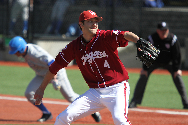 Chad Arnold (#4), Washington State senior pitcher, fires to the plate during the Cougars Pac-10 conference baseball game against UCLA at Bailey-Brayton Field in Pullman, Washington, on April 9, 2011.  Arnold continued his comeback from surgery and pitched well, but the Bruins came back to win the game, 10-3.