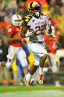 Cameron Chism of the Terrapins heads for the end zone after intercepting the ball. Maryland defeated Miami 32-24 during a game at the Byrd Stadium in College Park, MD on Monday, September 5, 2011. Alan P. Santos/DC Sports Box