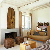 The main living area was previously a hay store with a rough dirt floor which was replaced with one of untreated travertine and the walls are finished with a textured stucco