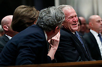Former President George W. Bush smiles with his brother Jeb Bush and Laura Bush, center, at the State Funeral for their father, former President George H.W. Bush, at the National Cathedral, Wednesday, Dec. 5, 2018, in Washington. <br /> CAP/MPI/RS<br /> &copy;RS/MPI/Capital Pictures