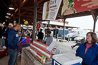 A man peruses the stall of a vendor selling Jamaican seasonings in Detroit Eastern Farmers market in Detroit (Mi) Saturday June 8, 2013. The largest open-air flowerbed market in the United States, the Eastern Market is a historic commercial district in Detroit, Michigan.