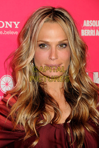 MOLLY SIMS.US Weekly Hot Hollywood Style Issue Event held at Drai's at the W Hollywood Hotel, Hollywood, California, USA..April 22nd, 2010.headshot portrait simms red maroon burgundy dangling gold earrings.CAP/ADM/BP.©Byron Purvis/AdMedia/Capital Pictures.