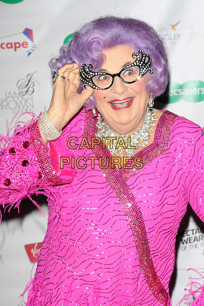 Dame Edna Everage (Barry Humphries)<br /> The Specsavers Awards, held at the Royal Opera House, Covent Garden, London, England.<br /> September 10th, 2013<br /> half length glasses purple wig pink wrap sequins sequined jacket dress cross dresser diamond necklace rhinestone frames hand arm mouth open<br /> CAP/CJ<br /> &copy;Chris Joseph/Capital Pictures