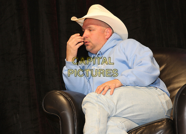 GARTH BROOKS.Country Superstar Garth Brooks makes a rare appearance and performs at CRS in Nashville, Tennessee, USA..March 5th, 2008.half length blue top hat cream stetson cowboy profile hans sitting jeans denim legs crossed .CAP/ADM/RR.©Randi Radcliff/AdMedia/Capital Pictures.