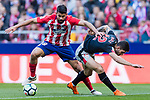Diego Costa of Atletico de Madrid (L) fights for the ball with Unai Nunez Gestoso of Athletic Club de Bilbao (R) during the La Liga 2017-18 match between Atletico de Madrid and Athletic de Bilbao at Wanda Metropolitano  on February 18 2018 in Madrid, Spain. Photo by Diego Souto / Power Sport Images