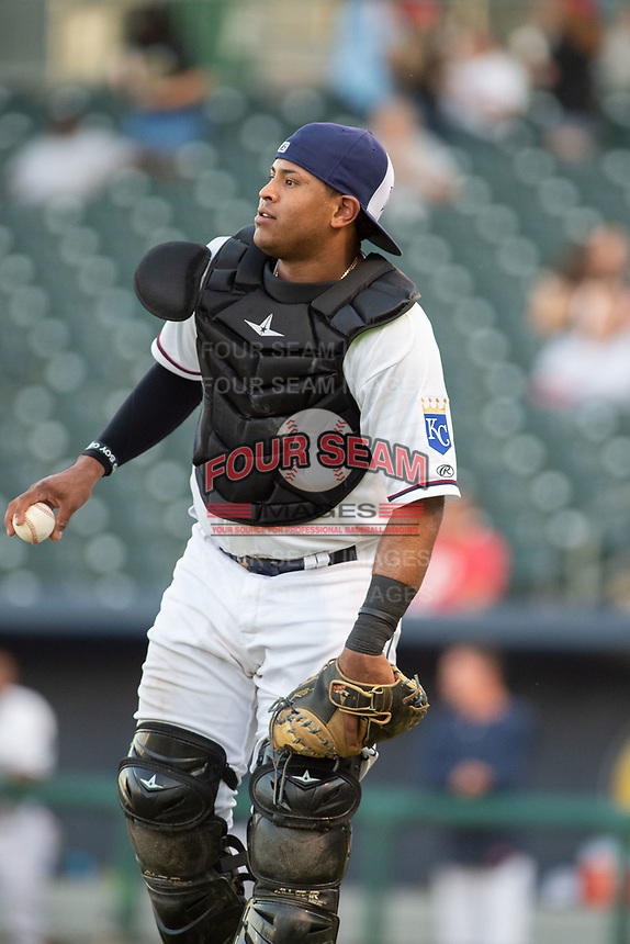 Northwest Arkansas Naturals catcher Meibrys Viloria (22) looks to toss back to the mound on May 16, 2019, at Arvest Ballpark in Springdale, Arkansas. (Jason Ivester/Four Seam Images)