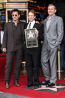 HOLLYWOOD, CA - JUNE 24: Johnny Depp, Jerry Bruckheimer and Bob Iger attend the ceremony honoring Jerry Bruckheimer with a Star on The Hollywood Walk of Fame held in front of El Capitan Theatre on June 24, 2013 in Hollywood, California. (Photo by Celebrity Monitor)
