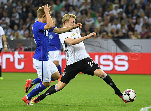 31.08.2016 Moenchengladbach, Germany. International football freindly. Germany versus Finland.  Jere Uronen (Finland), Julian Brandt (germany)
