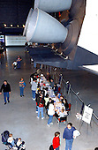 Children draw their own version of the Space Shuttle underneath the tail section of the Space Shuttle Enterprise during the first anniversary celebration of the Smithsonian National Air and Space Museum Steven F. Udvar-Hazy Center in Chantilly, Virginia on December 11, 2004..Credit: Ron Sachs / CNP.(RESTRICTION: NO New York or New Jersey Newspapers or newspapers within a 75 mile radius of New York City)
