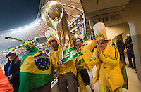Several Brazil supporters carrying a large replica of the FIFA World Cup trophy walk to their seats before the FIFA World Cup first round match between Ivory Coast and Brazil at Soccer City in Johannesburg, South Africa on Sunday, June 20, 2010.