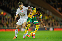 Federico Fernandez of Swansea City and Dieumerci Mbokani of Norwich City during the Barclays Premier League match between Norwich City and Swansea City played at Carrow Road, Norwich on November 7th 2015