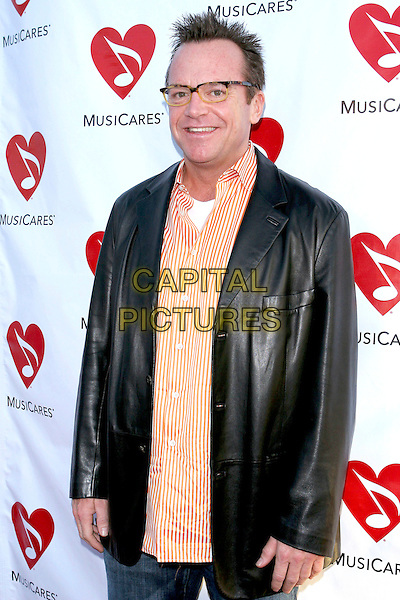 TOM ARNOLD.Attends The Musicares Map Fund Concert to Honor Goldenvoice held at The Henry Fonda Music Box Theatre in Hollywood, California, USA, May 20th 2005..half length orange striped shirt glasses.Ref: ADM.www.capitalpictures.com.sales@capitalpictures.com.©JWong/AdMedia/Capital Pictures.
