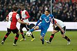 Nederland, Rotterdam, 27 januari  2013.Eredivisie.Seizoen 2012/2013.Feyenoord-FC Twente.Luc Castaignos van FC Twente  in duel om de bal met Joris Mathijsen van Feyenoord