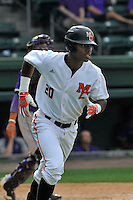 Center fielder Kyle Lewis (20) of the Mercer Bears runs out a ball in a SoCon Tournament game against the Furman Paladins on Thursday, May 26, 2016, at Fluor Field at the West End in Greenville, South Carolina. Mercer won, 6-1. Lewis is considered a 2016 Top 5 draft pick. (Tom Priddy/Four Seam Images)