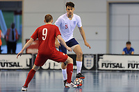Maximilian Kilman of England holds up the ball from Tomasz Lutecki of Poland during England vs Poland, International Futsal Friendly at St George's Park on 2nd June 2018