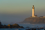 Waves and coastal rocks at Pigeon Point Lighthouse at sunrise, San Mateo County coast, California