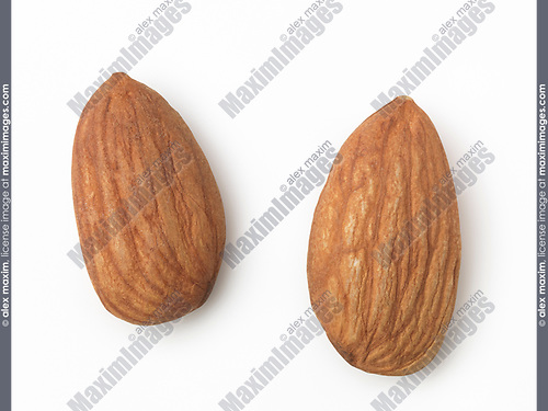 Closeup of two shelled almonds, almond nuts, isolated on white background